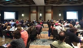 Entrinsik customers in large ballroom listening to presentation